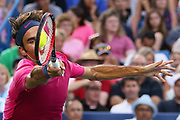 Roger Federer of Switzerland returns a forehand to Roberto Bautista Agut of Spain during Day 4 of the Western & Southern Open at the Lidler Family Tennis Center on August 18, 2015 in Cincinnati, Ohio.