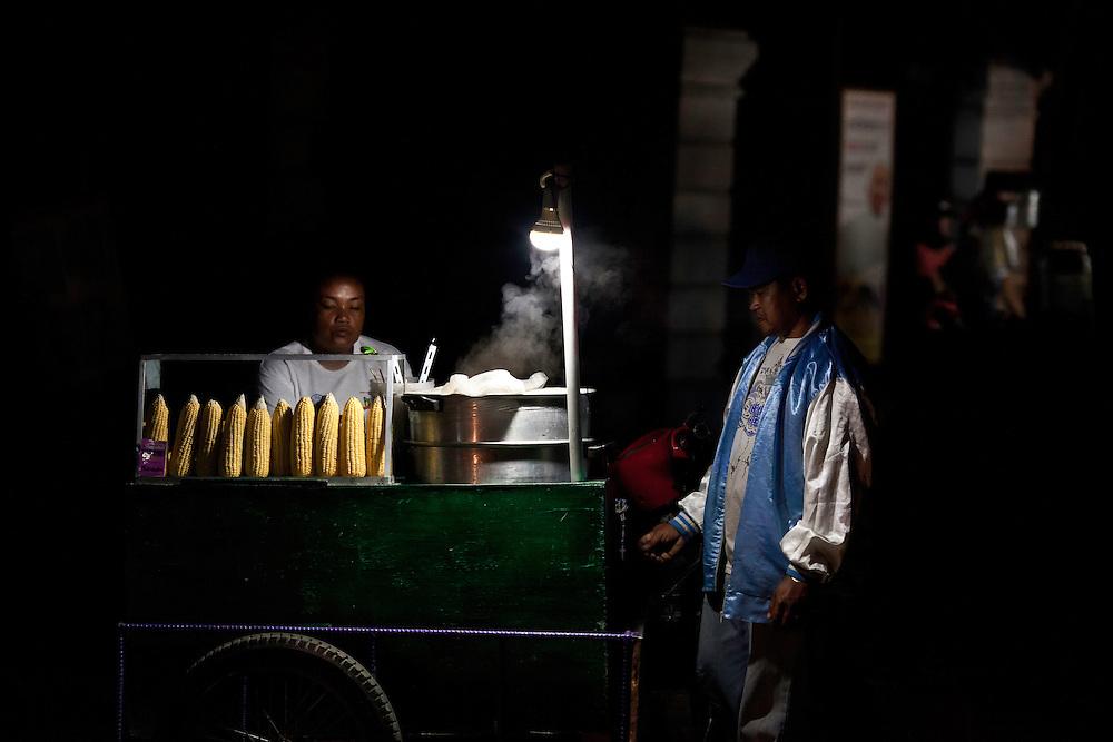 Woman sells corn on street corner in Vigan, Philippines. Copyright 2015 Reid McNally.