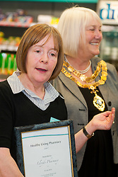 Lloyds Pharmacy Stocksbridge has achieved the status of 'Healthy Living Pharmacy'. A special accreditation for offering high levels of health screening  and advice to the local community. ..Pharmacy Manager Jackie Walter and the Mayor of Stocksbridge Susie Abrahams..04 October 2012.Image © Paul David Drabble