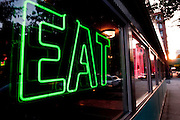 A neon sign in downtown Chicago calling people into the restaurant to 'Eat'. Missoula Photographer