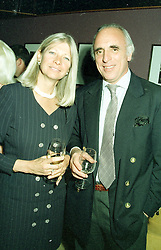 MR & MRS BRYAN MORRISON he is chairman of the Royal Berkshire Polo Club, at a party on April 22nd 1997.LXW 31