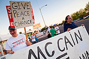 26 SEPTEMBER 2010 - PHOENIX, AZ: People picket against Sen. John McCain in Phoenix Sunday. About 200 people demonstrated and picketed against Arizona Republican Senator John McCain at the studios of KTVK TV in Phoenix, Sunday, Sept 26. They picketed the TV station because McCain was debating his opponents there. They were demonstrating against McCain's positions on the war in Afghanistan, Don't Ask Don't Tell (Gays in the military) and the DREAM Act (for immigrant rights). PHOTO BY JACK KURTZ