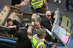 20 November 2015. Orpheum Theater, New Orleans, Louisiana. <br /> Memorial service for musician Allen Toussaint. Toussaint's Rolls Royce is driven away as the service spills out of the Orpheum Theater in a second line procession following the touching memorial service for one of the city's most influential musicians. <br /> Photo; Charlie Varley/varleypix.com