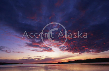 Canada. Northwest Territories. Mackenzie River with Midnight Sun obscured by clouds.