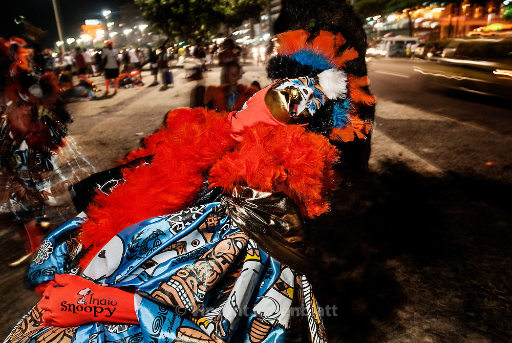 A Bate Bola clown get asleep in Copacana, after 48 hours of parade with his gang in the streets of Rio. .The gang of the Indian (Turma do Indio) is based in the district of Guadalupe, suburb of Rio de Janeiro. Pacific oriented, they use a totem and a soft toy instead of the ball - as a sign of non agressivity.  .
