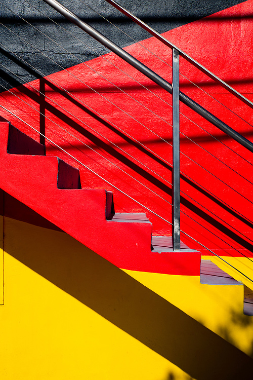 Brightly painted staircase on a small Miami Modern (MiMo) style apartment house in Miami's Wynwood arts district, famous for its graffiti- and mural-rich walls and other street art