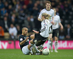 DERBY, ENGLAND - Saturday, March 12, 2011: Swansea City's Darren Pratley and Derby County's Robbie Savage during the Football League Championship match at Pride Park. (Photo by David Rawcliffe/Propaganda)