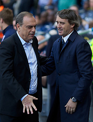 MANCHESTER, ENGLAND - Sunday, May 1, 2011: Manchester City's manager Roberto Mancini and West Ham United's manager Avram Grant during the Premiership match at the City of Manchester Stadium. (Photo by David Tickle/Propaganda)