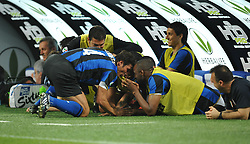 Zanetti and his team mates share a joke on the bench.