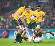Twickenham, Surrey. UK. Sean MCMAHON, attemts to shake of Dylan HARTLEY'S low tackle, during the <br />