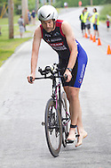 Monroe, New York - Christopherr Loftus of Chester, New York, finishes the 13-mile bicycle leg in the third annual Southern Orange Family YMCA Tri/Duathlon & Run/Walk on Aug. 2, 2014.