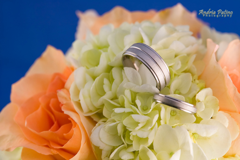 Wedding bands in bouquet of flowers