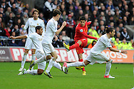 Swansea city players block a shot from Liverpool's Luis Suarez. Barclays Premier league, Swansea city v Liverpool at the Liberty Stadium in Swansea , South Wales on Sunday 25th November 2012. pic by Andrew Orchard, Andrew Orchard sports photography,