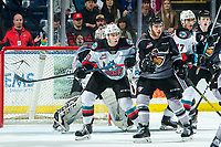 KELOWNA, BC - JANUARY 4:  Alex Swetlikoff #17 and Ethan Ernst #19 of the Kelowna Rockets check Connor Horning #22 and Seth Bafaro #27 of the Vancouver Giants during third period at Prospera Place on January 4, 2020 in Kelowna, Canada. (Photo by Marissa Baecker/Shoot the Breeze)