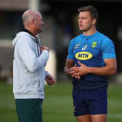 LONDON, ENGLAND - OCTOBER 29: Jacques Nienaber (Defence Coach) of South Africa talking to Handre Pollard during the South African national rugby team training session at Latymer Lower School on October 29, 2018 in London, England. (Photo by Steve Haag/Gallo Images)