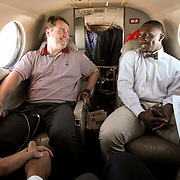 Muschamp and Deebo Samuel talk onboard the plane. ©Travis Bell Photography