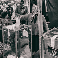 11 of May 2014 - Ukraine - Donetsk - Woman putting her vote in the ballot. Front of the occupied administration building of Donetsk.