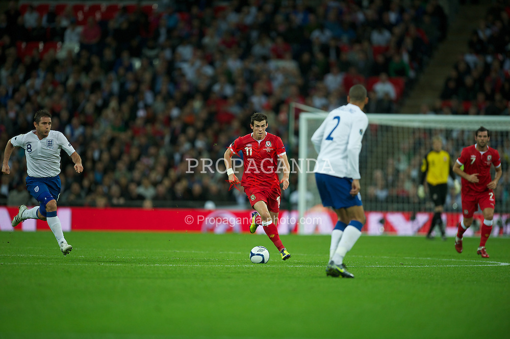 LONDON, ENGLAND - Tuesday, September 6, 2011: Wales' Gareth Bale in action against England during the UEFA Euro 2012 Qualifying Group G match at Wembley Stadium. (Pic by David Rawcliffe/Propaganda)