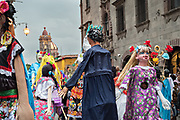 A parade of giant paper mache puppets called mojigangas dance in a procession through the city at the start of the week long fiesta of the patron saint Saint Michael September 22, 2017 in San Miguel de Allende, Mexico.