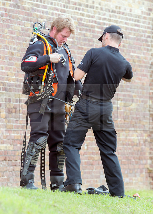© Licensed to London News Pictures. 09/09/2014. Hanwell, UK. Police divers on the tow path.  Police continue to cordon off a section of the Grand Union Canal in Isleworth in the search for missing school girl Alice Gross today 9th September 2014.  Alice Gross of Hanwell, west London, was last seen by her family at about 13:00 BST on 28 August. CCTV footage shows her walking along the Grand Union Canal tow path near the Holiday Inn at Brentford Lock between 13:30 BST and 17:30 BST.. Photo credit : Stephen Simpson/LNP