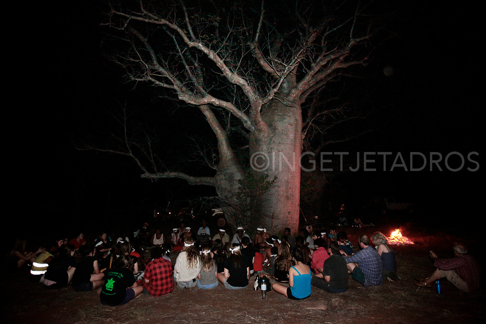 Students of The Yiramalay/Wesley Studio School gathered with Bunuba elders in front of a large boab tree as they where invited for the burial of Bunuba remains in a repatriation ceremony at Dingo Gap on Tunnel Creek Road. Tunnel Creek. WA