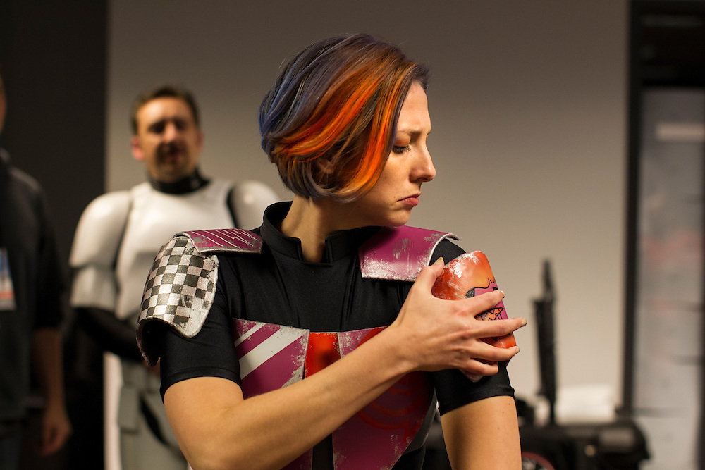 Ashley Hay of St. Paul puts the last touches on her Sabine costume at Star Wars night at the Timberwolves game at Target Center in Minneapolis December 15, 2015.