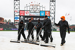 SAN FRANCISCO, CA - APRIL 09:  Members of the San Francisco Giants groundskeeper crew push water off the infield tarp during a rain shower before the game against the Los Angeles Dodgers at AT&T Park on April 9, 2016 in San Francisco, California.  (Photo by Jason O. Watson/Getty Images) *** Local Caption ***