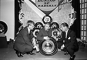 26/06/1967<br /> 06/26/1967<br /> 26 June 1967<br /> Motoring Enthusiasts Week officially opened by Joe Lynch at the International Trade Promotion Centre, Dublin. Image shows Joe Lynch (centre) discussing Dunlop SP radial tyres with Mr. P. Duke (left) Sales Promotion Representative, Irish Dunlop Co. and Mr. Noel Coade, Managing Director, International Trade Promotion Centre.