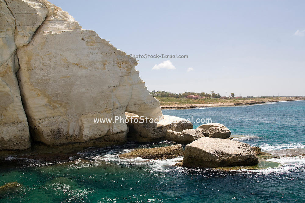 Israel. Rosh Hanikra The white cliff is a chalk cliff on the beach of Upper-Galilee on the border between Israel and Lebanon, chiselled out into labyrinthine grottoes filled with seawater formed by the geological and biological processes and by waves lapping on the soft rock.