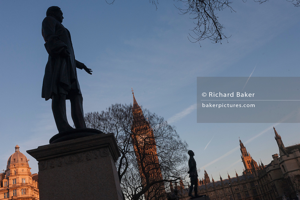 A silhouetted statues of Lord Palmerston and Jan Smuts, on 17th January 2017, in Parliament Square, Westminster, London England. Palmerston's statue on the left, is an outdoor bronze sculpture of Henry John Temple, 3rd Viscount Palmerston, located at Parliament Square in London, United Kingdom. Sculpted by Thomas Woolner and unveiled in 1876, it is Grade II listed. Jan Smuts in the background is a bronze sculpture by Jacob Epstein.