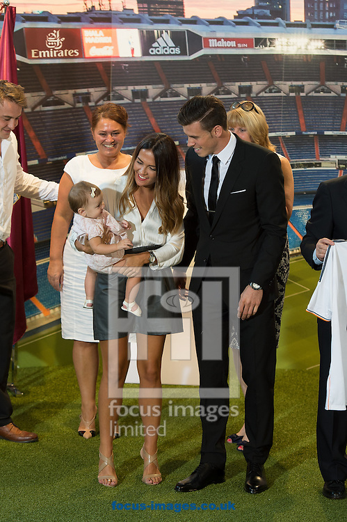Picture by Sam Wordley/Focus Images Ltd +34 605 350 422<br /> 02/09/2013<br /> New signing Gareth Bale with long term girlfiriend Emma Rhys-Jones and their daughter Alba Violet Bale as he is presented at the Estadio Santiago Bernabeu, Madrid.