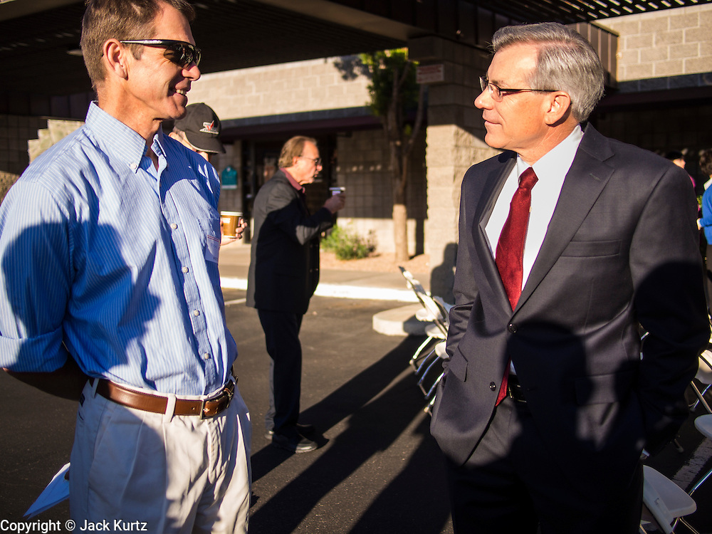 09 NOVEMBER 2013 - PHOENIX, AZ:  US Representative DAVID SCHWEIKERT (R-AZ), right, talks to a constituent in front of his district office in Scottsdale. Congressman Schweikert represents Arizona's 6th Congressional District. Most of the district is in Scottsdale, a wealthy suburb of Phoenix and one of the wealthiest cities in the United States. Schweikert is a staunch conservative and popular with the Tea Party. He supported the government shutdown in October.    PHOTO BY JACK KURTZ