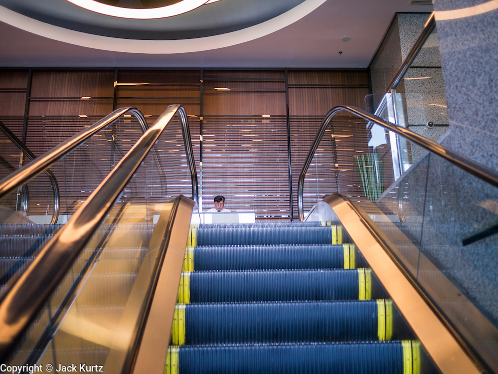 19 APRIL 2013 - BANGKOK, THAILAND:   An escalator leading into the Emporium Shopping Center on Sukhumvit Road in Bangkok. The Emporium is one of Bangkok's newer, more high end shopping complexes and is popular with both the expat and Thai HiSo (High Society).  PHOTO BY JACK KURTZ