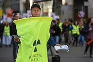 A demonstrator in a radioactive waste suit during the Time To Act, National Climate March organised by Campaign Against Climate Change in London, England on March 7, 2015