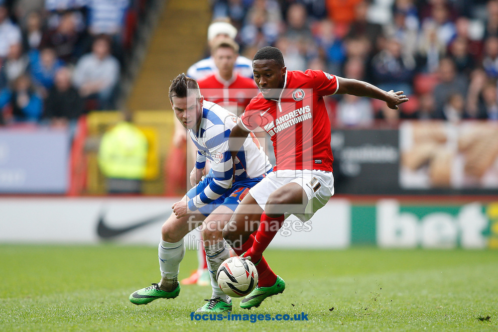 Callum Harriott of Charlton Athletic (R) goes past Danny Guthrie of Reading (L) during the Sky Bet Championship match at The Valley, London<br /> Picture by Andrew Tobin/Focus Images Ltd +44 7710 761829<br /> 05/04/2014