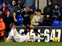 Photo: Jed Wee.<br />Tranmere Rovers v Swansea City. Coca Cola League 1.<br />26/11/2005.<br />Swansea's Lee Tundle hurdles over a sliding challenge from Tranmere's Simon Francis (R).