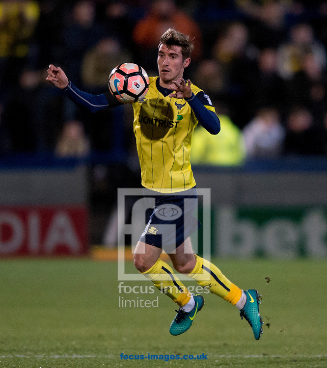 Joe Rothwell of Oxford United collects the ball during the FA Cup match at Moss Rose, Macclesfield<br /> Picture by Russell Hart/Focus Images Ltd 07791 688 420<br /> 02/12/2016
