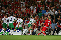 CARDIFF, WALES - Wednesday, September 8, 2004: Wales' Robbie Savage clashes with Northern Ireland's Michael Hughes before both are sent off during the Group Six World Cup Qualifier at the Millennium Stadium. (Pic by David Rawcliffe/Propaganda)