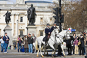 Community police officers on horseback in Trafalgar Square, London, England, United Kingdom