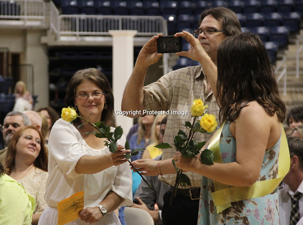 Parents of Tremont graduates received roses when their children's names were read.