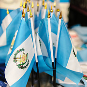 A cluster of small Guatemalan blue and white national flags for sale at the Mercado Municipal in Antigua for Guatemalan Independence Day.