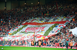 LIVERPOOL, ENGLAND - Saturday, September 26, 2009: Liverpool supporters on the Spion Kop unfurl a huge banner before the Premiership match at Anfield. (Photo by: David Rawcliffe/Propaganda)