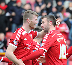 Swindon Town's John Swift celebrates scoring in the Sky Bet League One match between Swindon Town and Chesterfield at The County Ground on January 17, 2015 in Swindon, England. - Photo mandatory by-line: Paul Knight/JMP - Mobile: 07966 386802 - 17/01/2015 - SPORT - Football - Swindon - The County Ground - Swindon Town v Chesterfield - Sky Bet League One