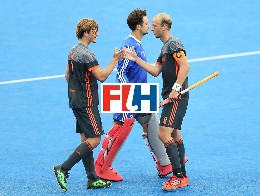 LONDON, ENGLAND - JUNE 24: Jorrit Croon of the Netherlands and Billy Bakker of the Netherlands embrace after the semi-final match between England and the Netherlands on day eight of the Hero Hockey World League Semi-Final at Lee Valley Hockey and Tennis Centre on June 24, 2017 in London, England. (Photo by Steve Bardens/Getty Images)
