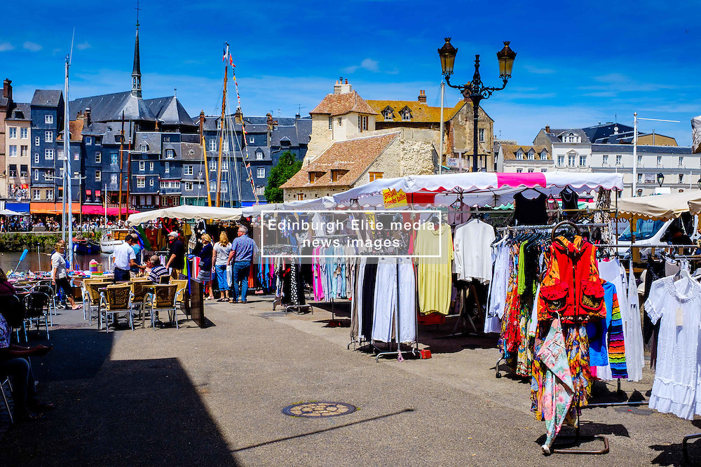 Market stalls by the harbour in Honfleur, Normandy, France