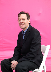 Dec 03 2007. New Orleans, Louisiana. Lower 9th Ward.<br /> Brad Pitt revisits the Lower 9th ward, devastated by Hurricane Katrina to present 'Make it Right' where architects' designs are unveiled to the public. One of the winning design Architects, Richard Maimon of Kieran Timberake Associates LLP of Philadelphia with a pink background for the pink project.<br /> Photo credit; Charlie Varley.