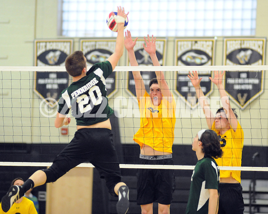 Pennridge's Aaron Nelson #20 spikes the ball as Central Bucks West's Zach Paley #23 and Will Varner #26 defend during a volleyball match at Central Bucks West Monday May 2, 2016 in Doylestown, Pennsylvania.  (Photo by William Thomas Cain)