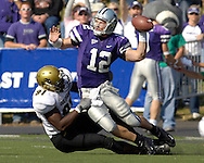 Colorado defensive end Maurice Lucas (91) pulls down Kansas State quarterback Allan Evridge (12) as he tries to get rid of the ball in the second quarter at KSU Stadium in Manhattan, Kansas, October 22, 2005.  The Buffaloes beat K-State 23-20.