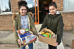 © Licensed to London News Pictures. 02/02/2016. London, UK. Two customers holding groceries outside the new easyFoodstore budget Supermarket in Park Royal, north London which is selling a range of food products all at 25p each. The discount shop, which is owned by the EasyJet company, offers shoppers groceries ranging from pasta to beans to cleaning products. Fresh meat, fruit and vegetables are not yet available. Photo credit: Ray Tang/LNP