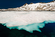 Ice over Lake Aloha in the Desolation wilderness area in south lake tahoe.